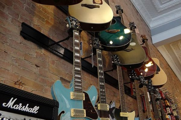 Picture of guitars hanging in the store